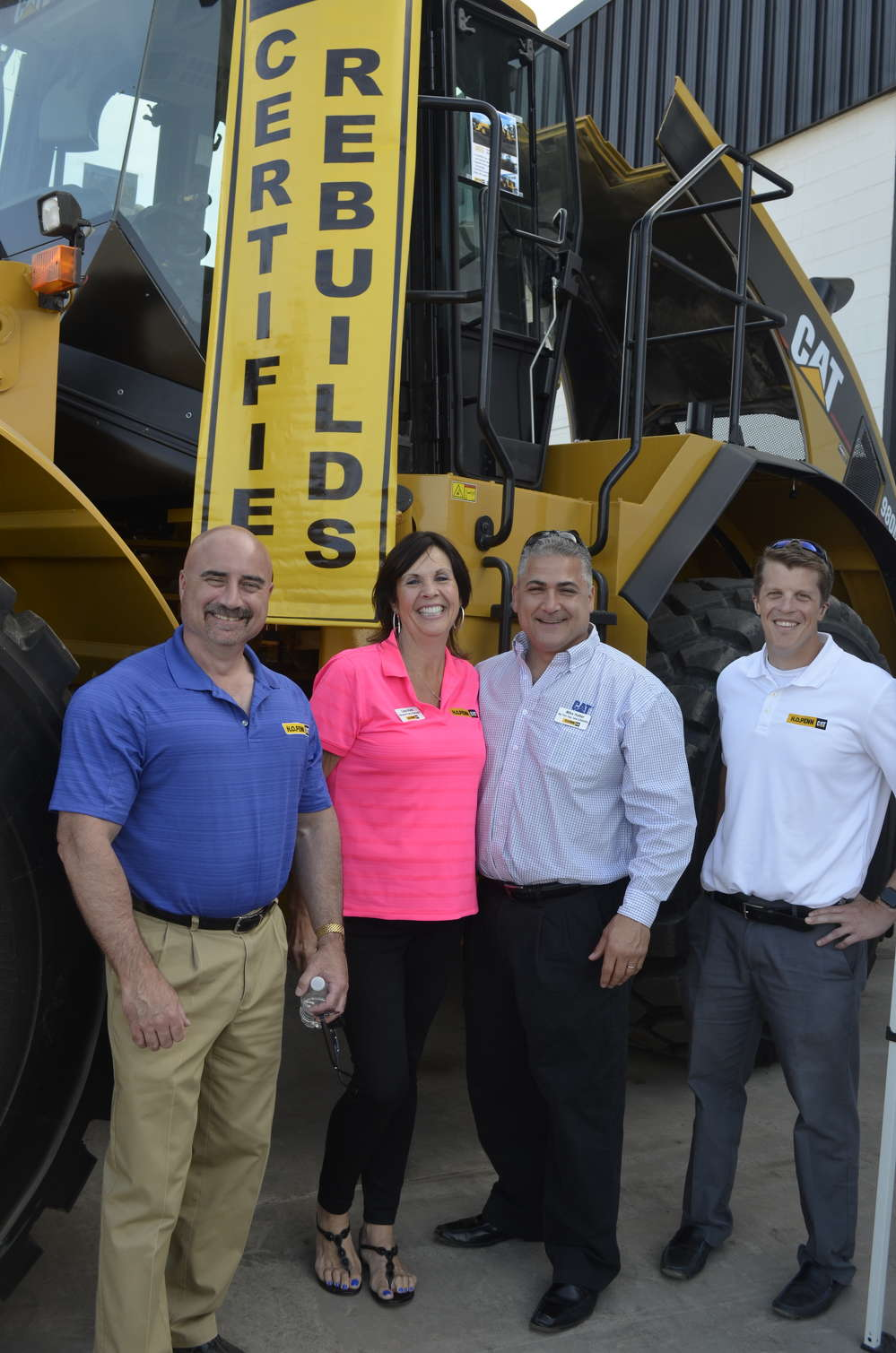 Cat Certified Rebuilds is an option available through H.O. Penn that significantly extends the life of equipment. (L-R): Jeff Mitchell, president of H.O. Penn; Lisa Katz, H.O. Penn general parts manager; Mike Hattar, H.O. Penn product support manager; and Giro Samale, Caterpillar Aftermarket Solutions Representative.