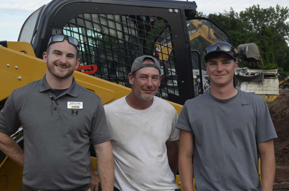 TDC Excavating was very impressed with the pushing power and climbing ability of the Caterpillar tracked loaders. (L-R): Nathan Galli of H.O. Penn with Paul Tetreault and Daniel Bilda, both of TDC Excavating in Taftville, Conn.