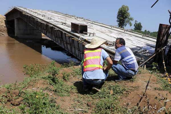 Chinese engineers inspect Sigiri bridge in Budalang'i on June 27, 2017. A team of experts from various organizations are on the ground to determine what could have led to the collapse.  (Tonny Omondi | Nation Media Group photo)