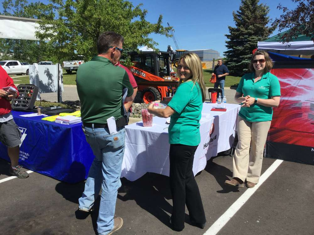 Sixteen local municipal equipment and services vendors, including Darleen Devereaux (C) of Haviland Enterprises showed off their products and equipment to Municipal Safety Day participants.