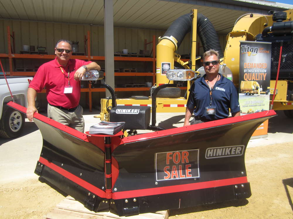 John Reese (L), Hiniker snow plows, and JR Carlson, retiree of Bonnell Industries Inc., catch up at the event.
