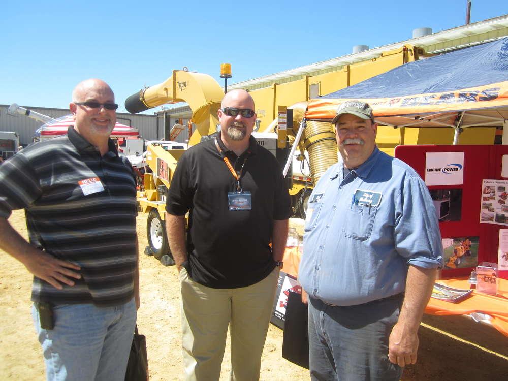 (L-R): Scott Schweda, city of McHenry; Jason Rumohr, Engine Power; and Matt Rogers, city of McHenry, discuss Kubota engines.