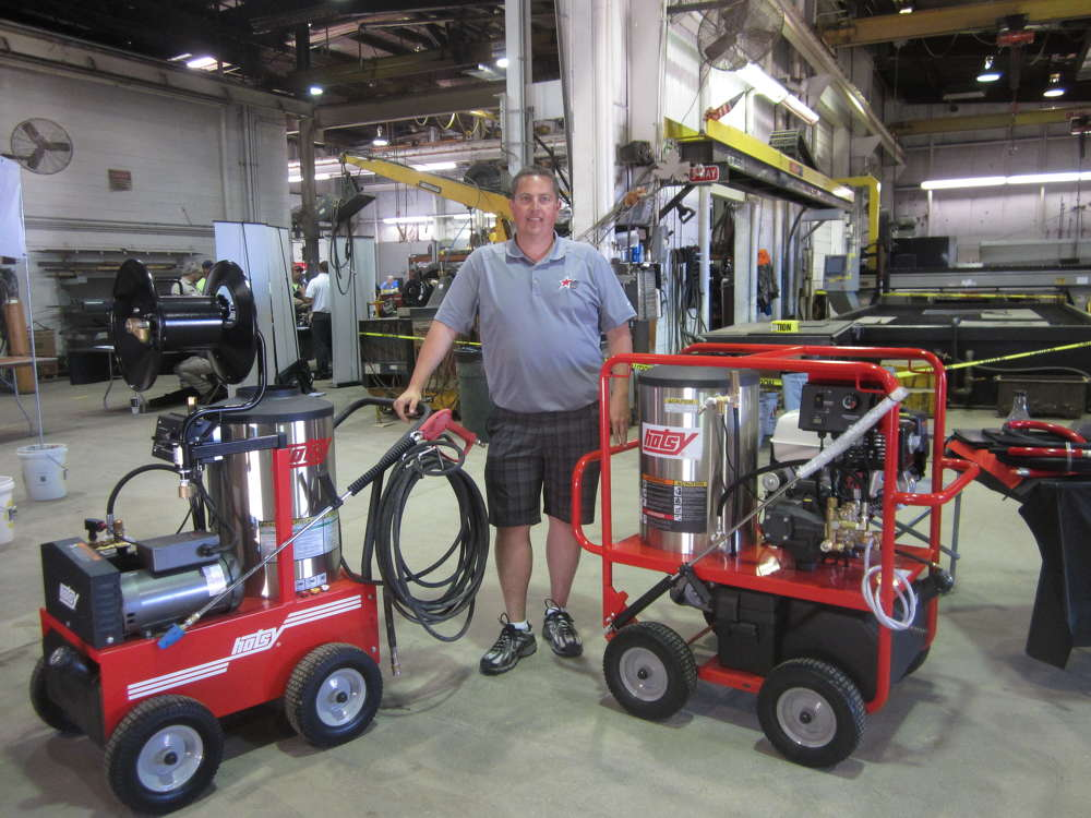 Dave Bickett of Hotsy Equipment demonstrates pressure washers at the equipment expo.