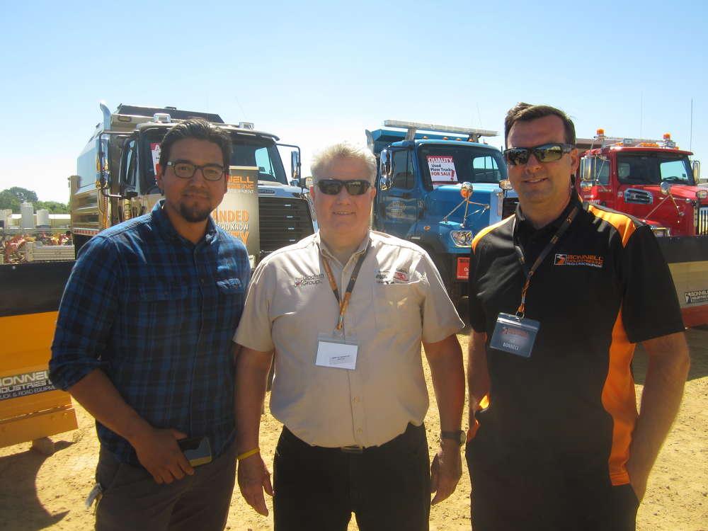 Joe Bonnell (R), president of Bonnell Industries Inc., welcomes Eric Alvarez (L), Hyva Corporation, and Scott Kleman, Champion Hoist & Equipment, to the equipment expo.