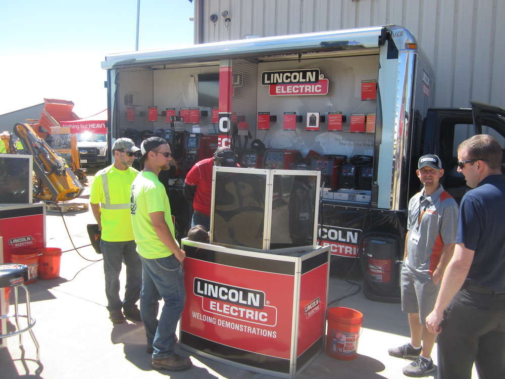 Guests stop by the Lincoln Electric demonstration booth.