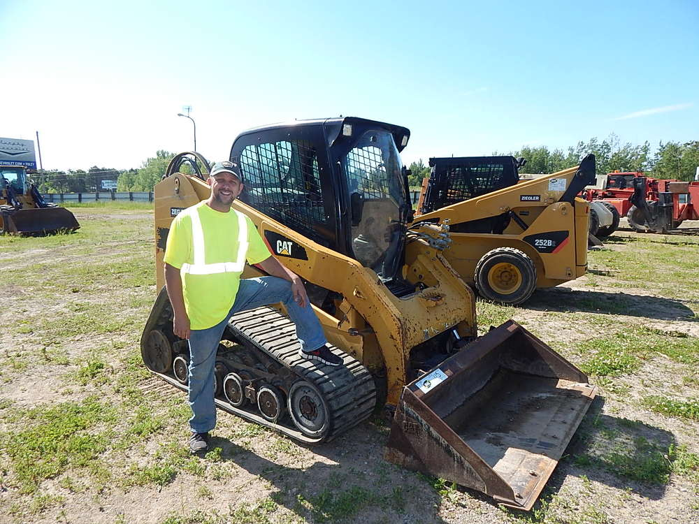 Blake Fjosne of Fjosne Construction, Willow River, Minn., is the new owner of this Cat 277C.