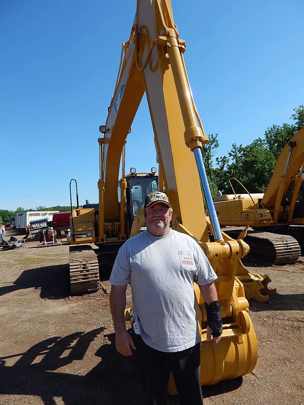 Richard Dumprope, Camp Ripley Heavy Equipment, Brainerd, Minn., takes a look at the excavators, and said he also is looking to buy one of the portable buildings for sale.