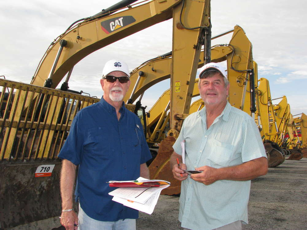 Richard Wood (L) of Row Equipment, Columbia, S.C., and E.B. Atkins of E B Atkins Construction, Columbia, S.C., go over the items they plan on bidding on.
