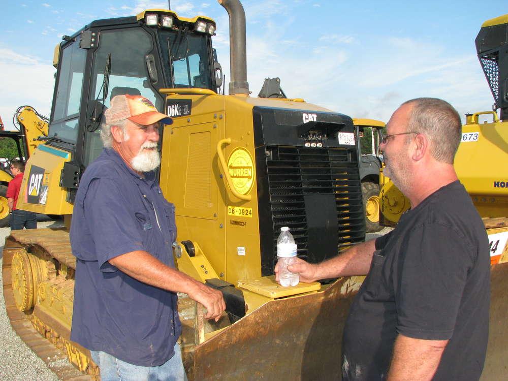 Randy Ward (L) and Roy LaFlamme, both of United Grading, Fairburn, Ga., consider bidding on this Cat D6K2 XL dozer.