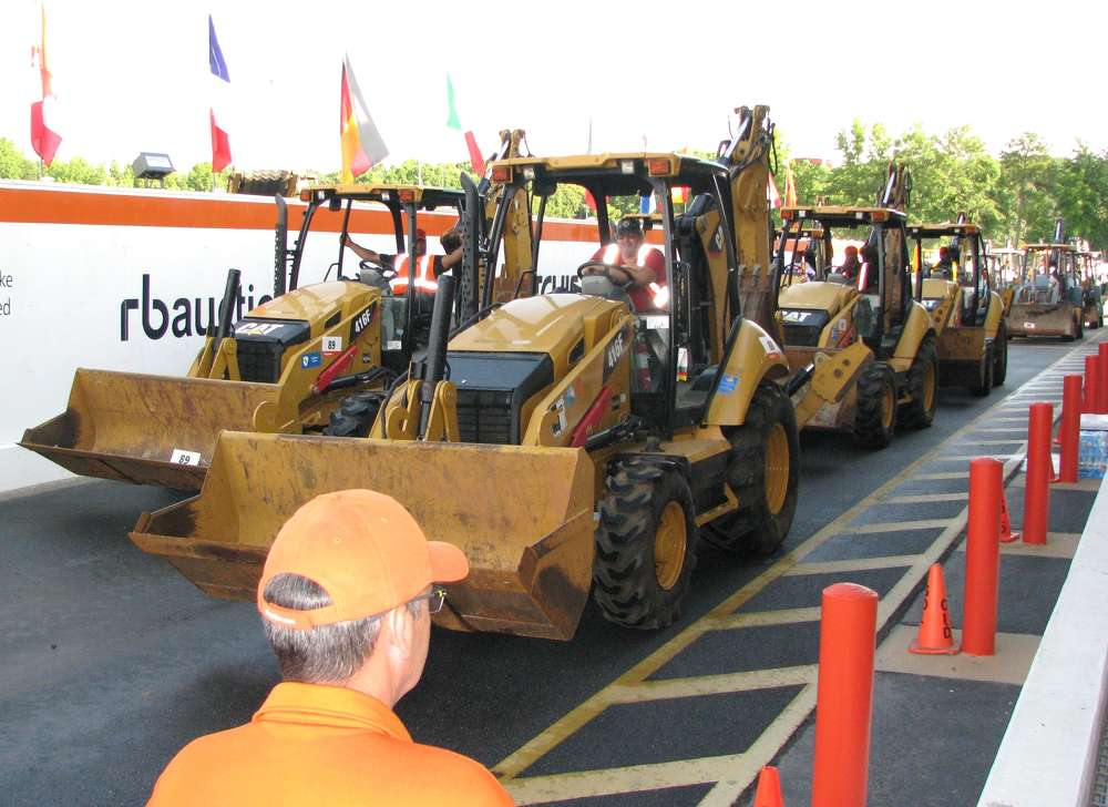 The Ritchie Bros. staff made quick work of auctioning the backhoe loaders before the heavy iron rolled across the ramp.