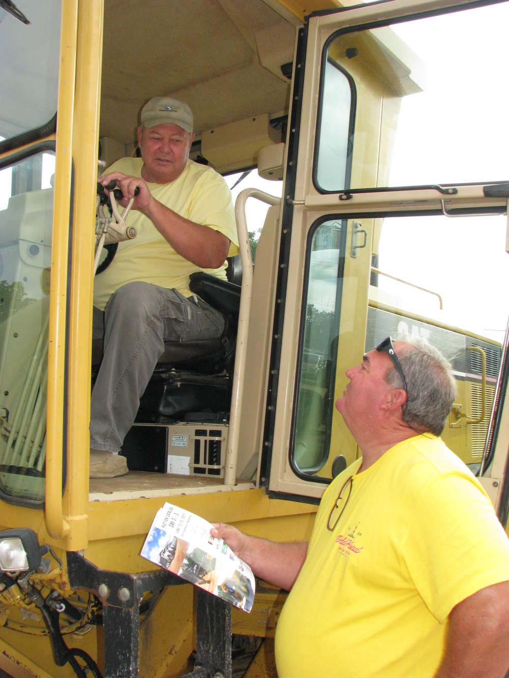 Michael (L) and Clay Norwood, both of Buddy's Sand & Gravel, Butler, Ala., consider this motorgrader.
