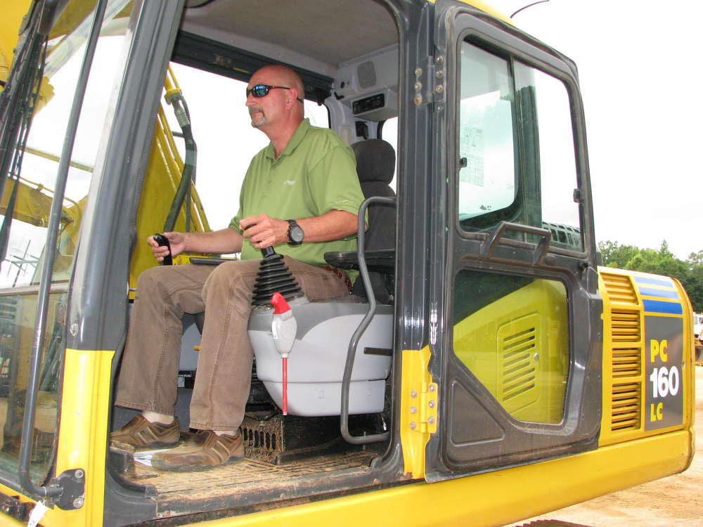 Tim Thomas of Tractor & Equipment Company, Birmingham, Ala., test-operates a Komatsu PC160LC excavator.
