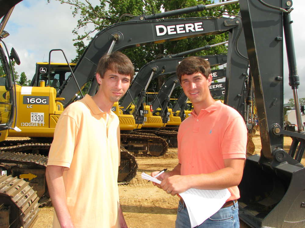 Neal (L) and Ben Lassiter of Dubose Construction, Mount Meigs, Ala., show interest in some of the late-model John Deere machines.