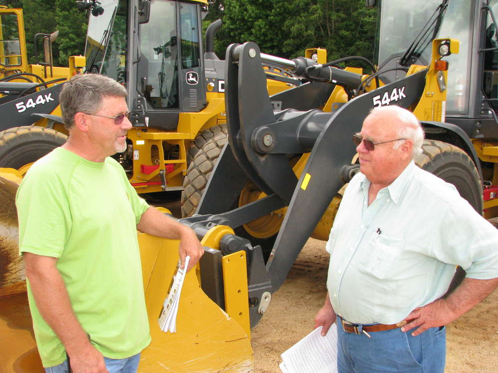 Kip Evans (L) of Kip Evans Logging, Gordo, Ala., and Gene Taylor of Warrior Tractor, Northport, Ala., discuss some of the wheel loaders.