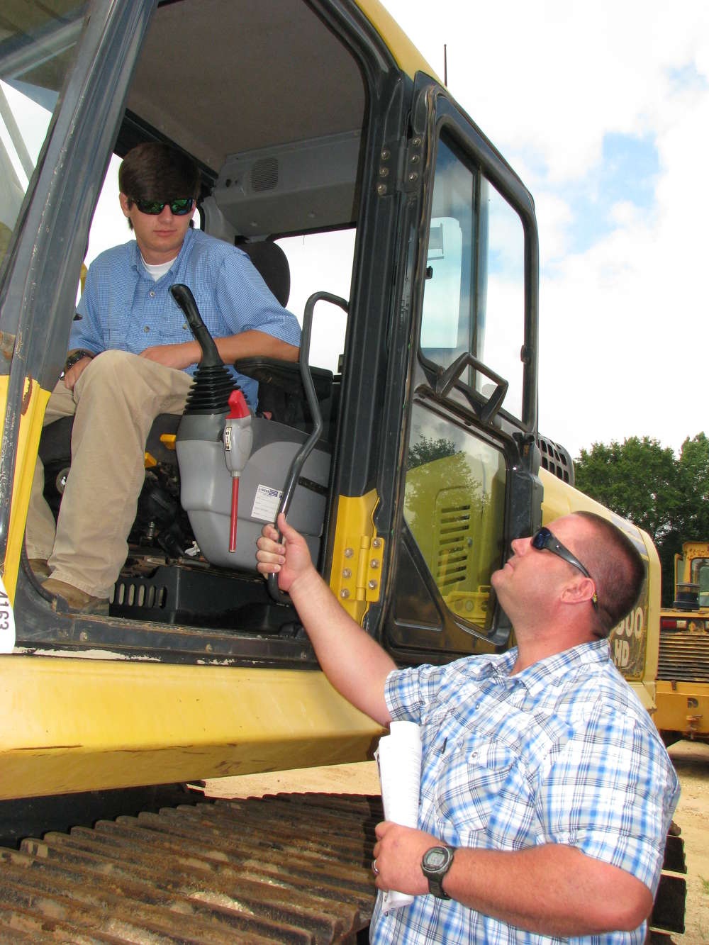 Peyton (L) and his dad, Adam Stanfield of AL Grading & Excavating, Montgomery, Ala., get a closer look at this Komatsu PC300HD.