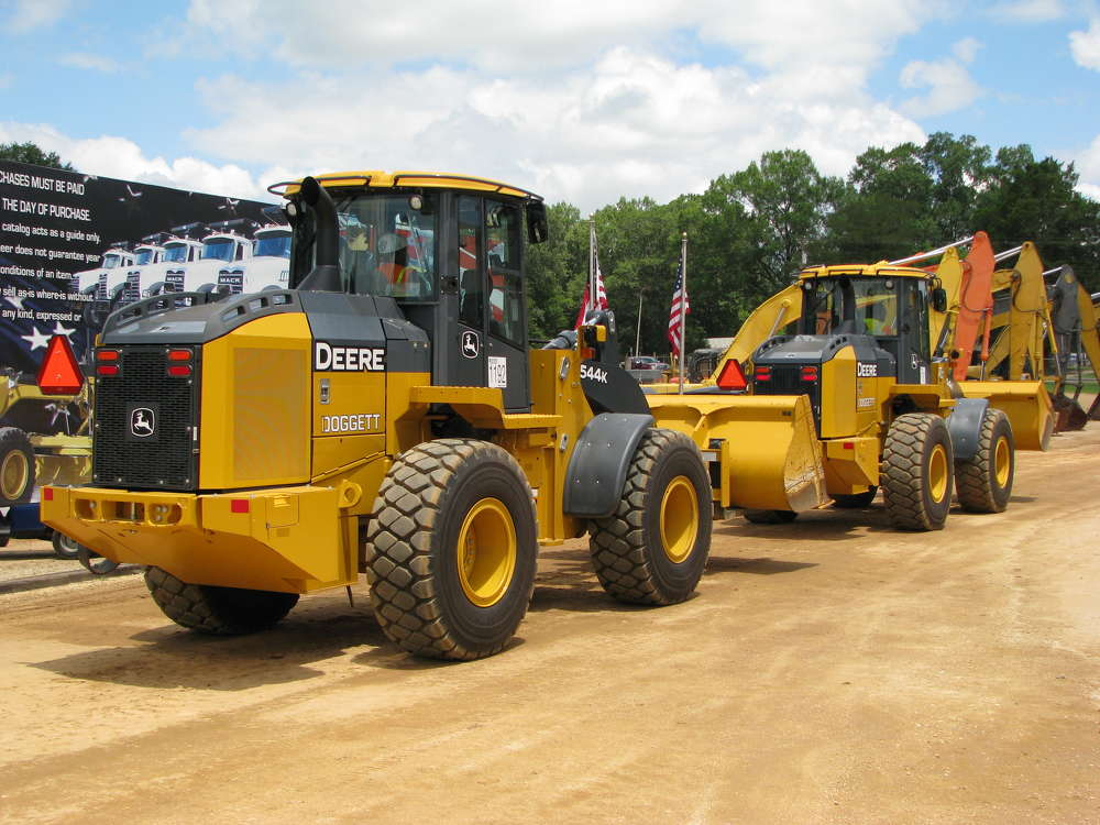 A pair of 2016 Deere 544K wheel loaders both rolled out at just over $130,000 each.