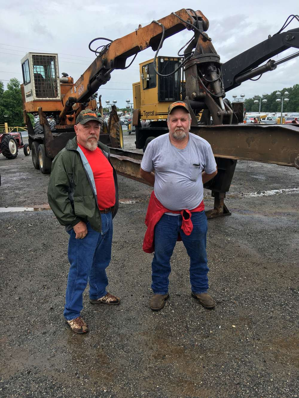 Hayward (L) and Jimmy Galloway, both of Galloway Logging & Excavating in Tuckasegee, N.C., looked over the logging machines and plan to bid on a few pieces.