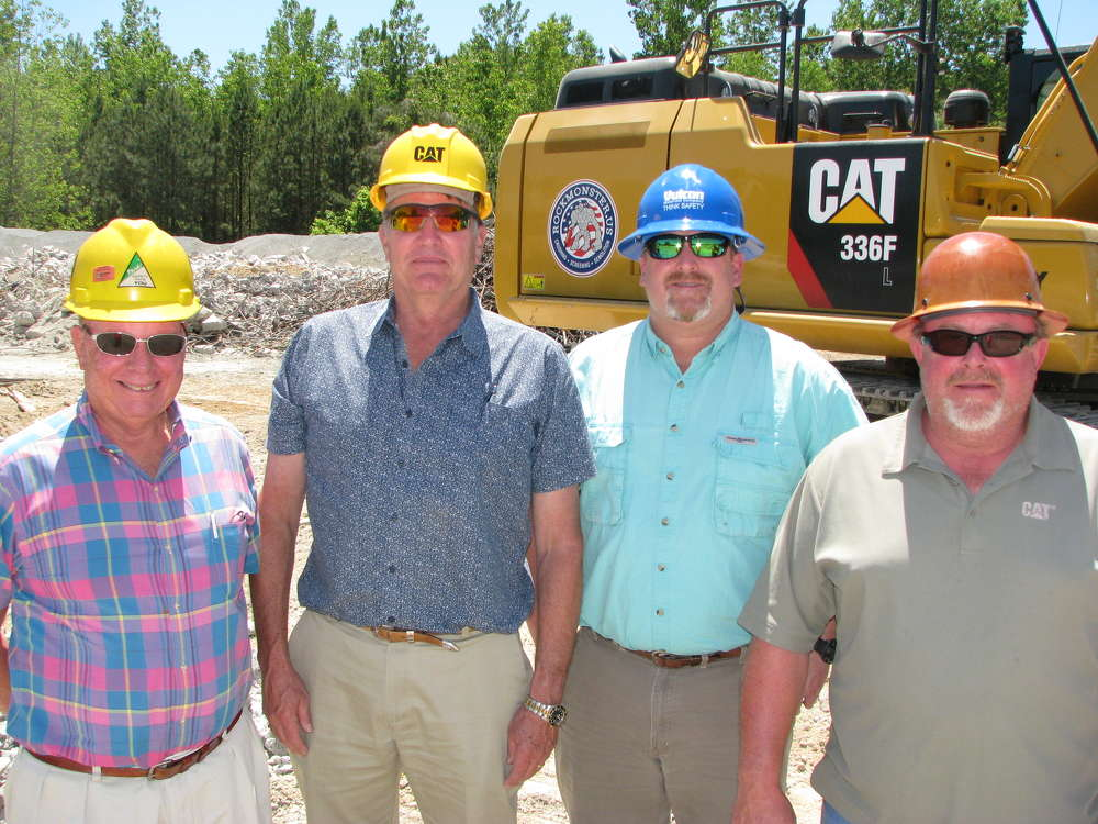 (L-R) are John Gorham and John McLean, Yancey Bros. Co. sales representatives; Shawn Greenway, Vulcan Materials, Norcross, Ga., plant manager; and Mike Turner, owner, Rockmonster.us.