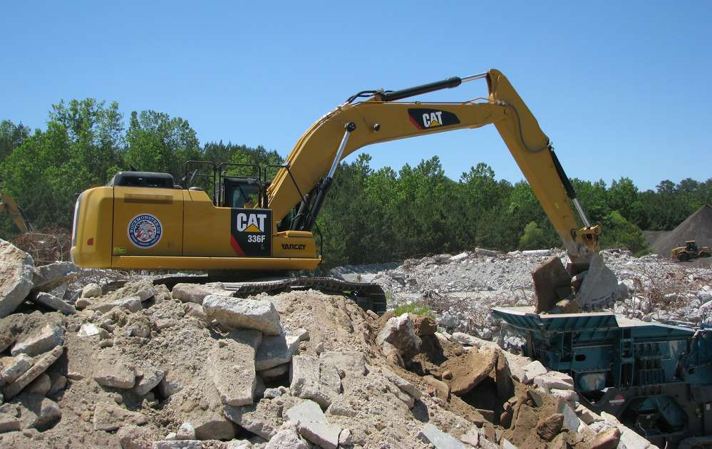 A Cat 336F excavator loads the Powerscreens for the crushing operation.