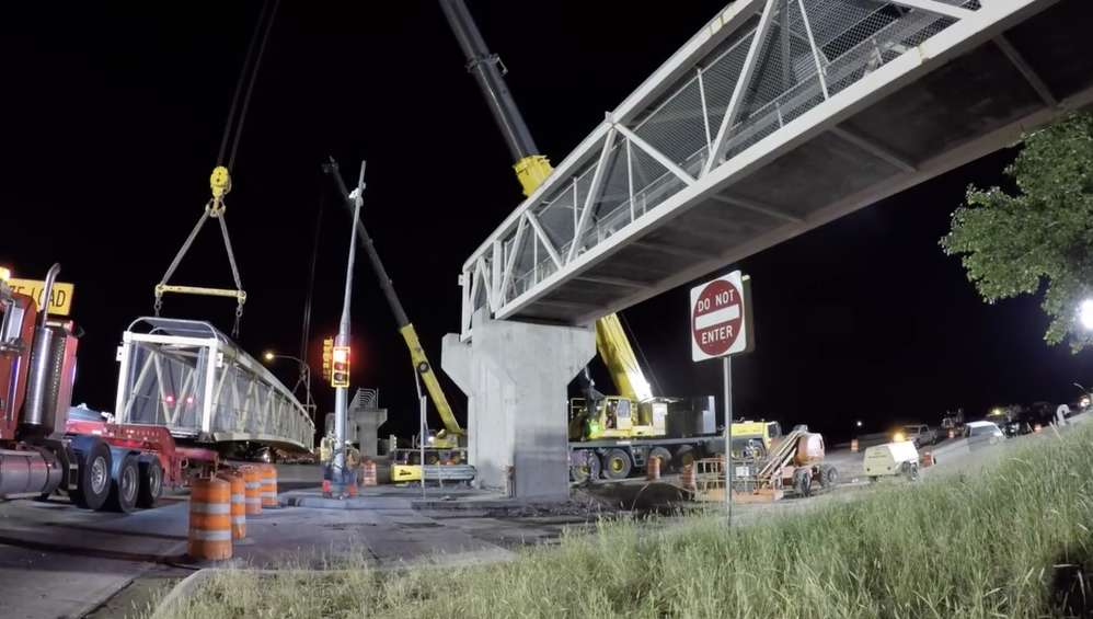 The bridge section is loaded onto a truck and will be reused.