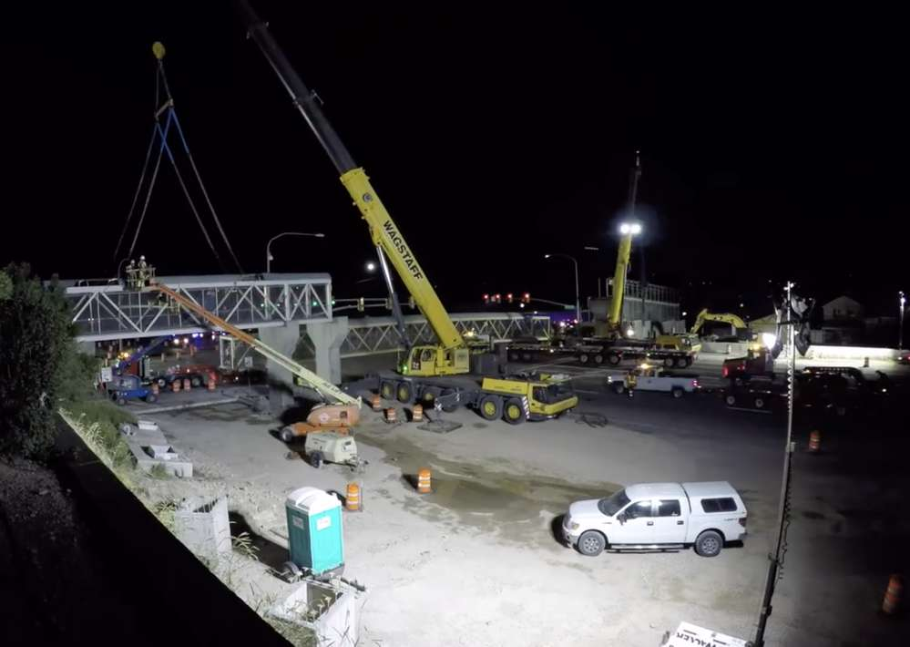 The cranes prepare to lift the next section.