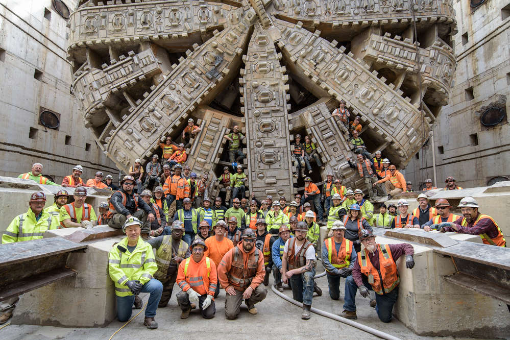 In this April 2017 photo, tunnel workers pose with the SR 99 tunneling machine after Bertha moved into the disassembly pit near Seattle Center. (WSDOT photo)