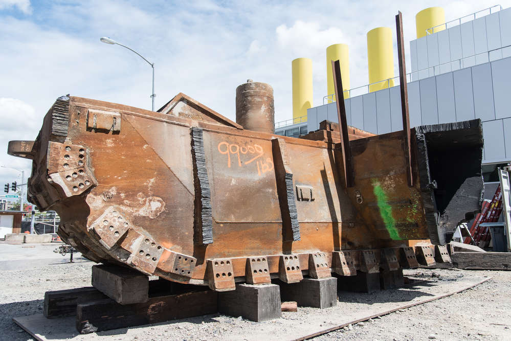 In this May 2017 photo, a piece of the SR 99 tunneling machine's cutterhead, weighing 99,000 lbs., awaits a trip to a metal recycling yard. Crews working for Seattle Tunnel Partners are removing the cutterhead one piece at a time inside the disassembly pit near Seattle Center. (WSDOT photo)
