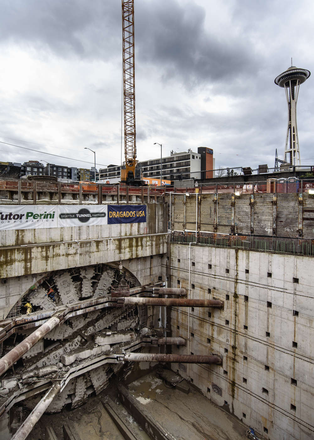 A look at Bertha, the SR 99 tunneling machine, in the pit near the Space Needle where she ended her 9,270-ft. journey beneath Seattle. Crews can be seen cleaning the massive machine's cutterhead. (WSDOT photo)