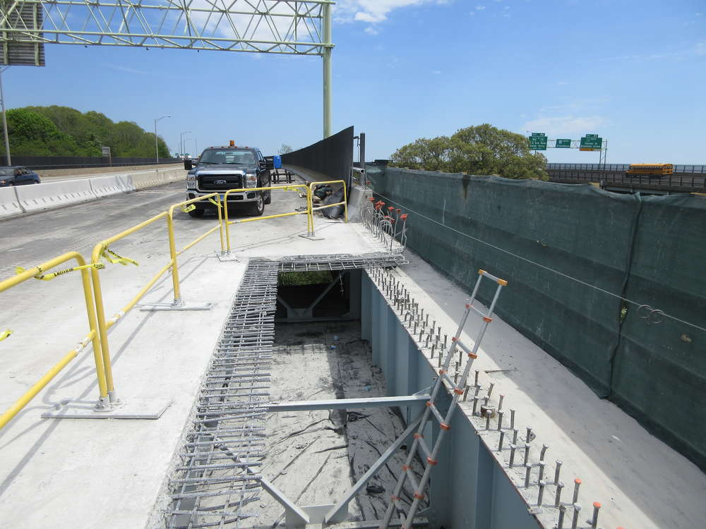 A few months into the project, workers are busy patching up concrete and repairing the southbound span. (ConnDOT photo)