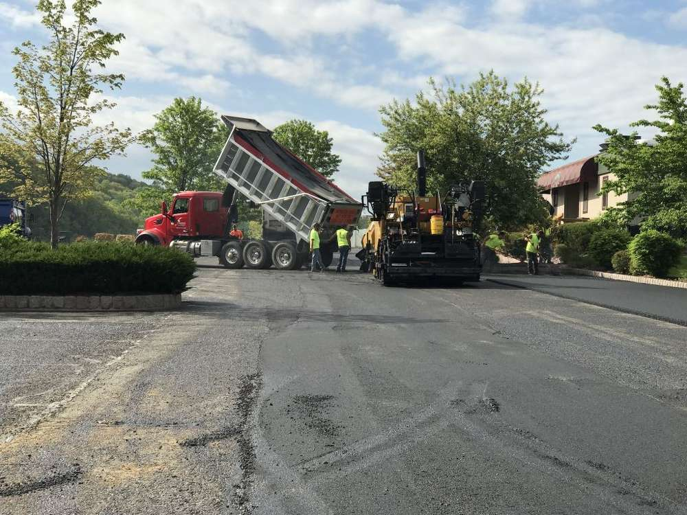 A Schlouch Incorporated?paving crew resurfaces the parking lot at The Riverview CC Clubhouse.
