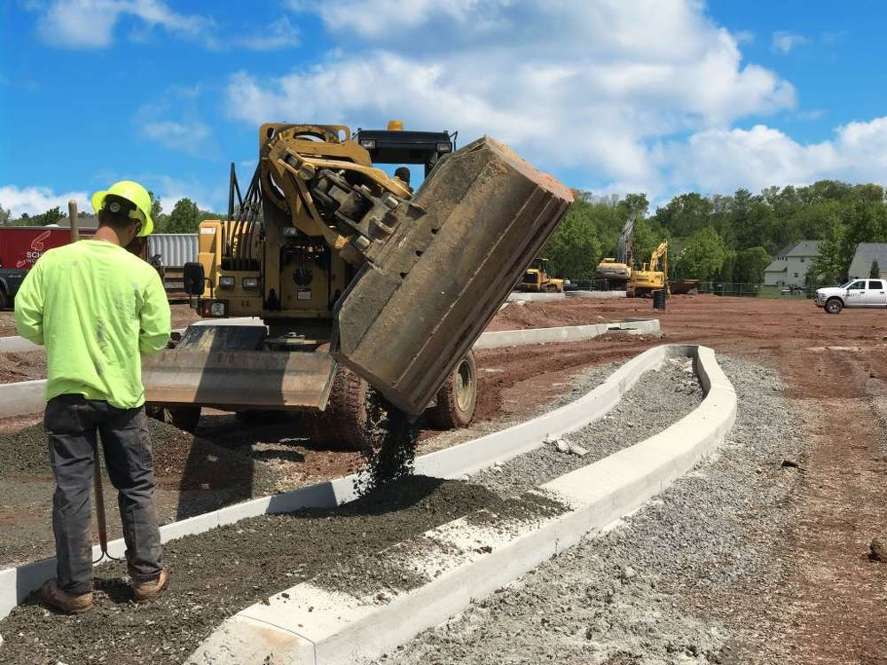 A Schlouch Incorporated team preps a curb island for the 10-acre site, The Shoppes at Upper Providence, Ridge Pike, Montgomery County.