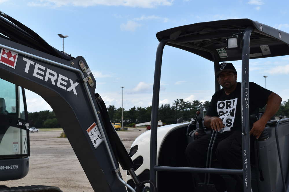 Uriah Chitolie, owner of Chitolie Trucking in St. Croix, U.S. Virgin Islands, tries out this Terex mini-excavator.