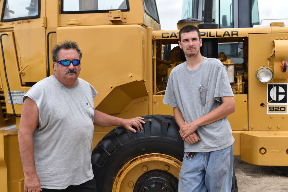 Greg DeGrazia (L) and his son, Greg DeGrazia Jr., are owners of Distinctive Lawns Inc. in Egg Harbor Township, N.J.