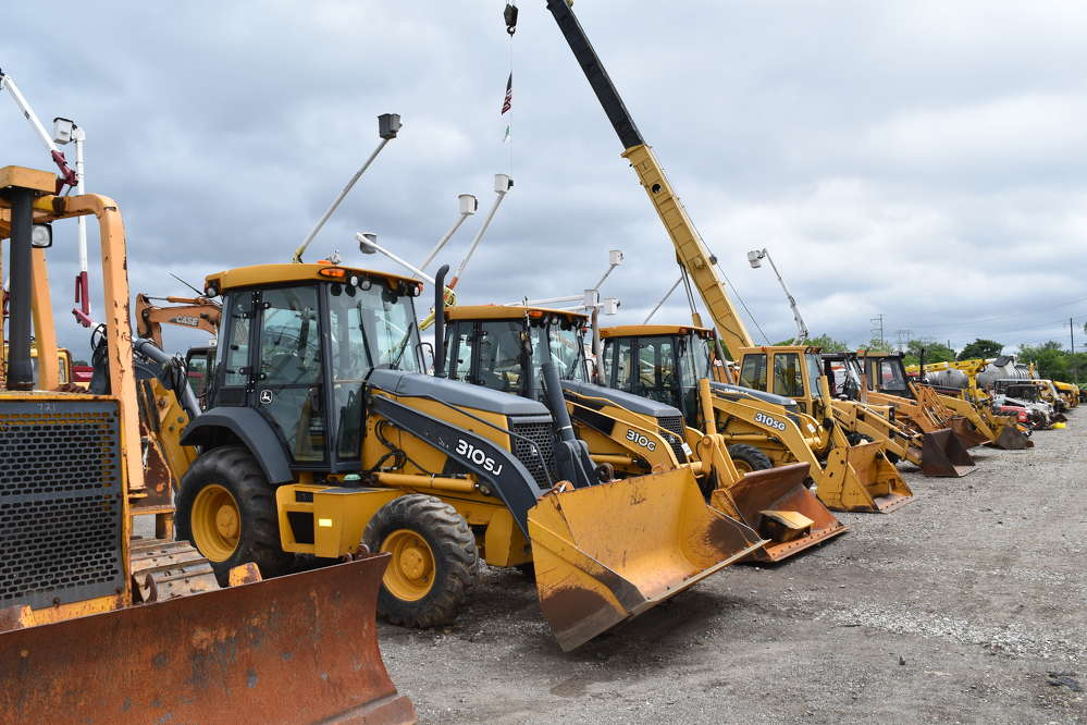 Backhoes and many other types of equipment went on the auction block during the sale in Plymouth Meeting, Pa.