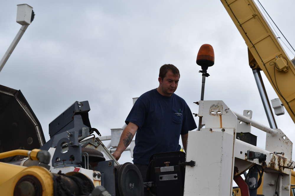 Tom Schmidt, vice president of Schmidt Paving LLC in Sellersville, Pa., checks out some equipment before bidding begins.
