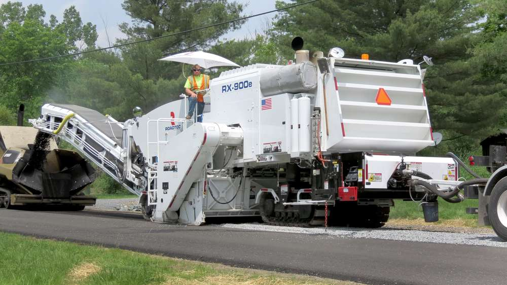 The Roadtec CIR additive system is used in the cold-in-place recycling of asphalt pavement in the repair and rehabilitation of asphalt-paved roads. Mounted to the rear of the milling machine, the CIR additive system is the same width as the mainframe of the milling machine.