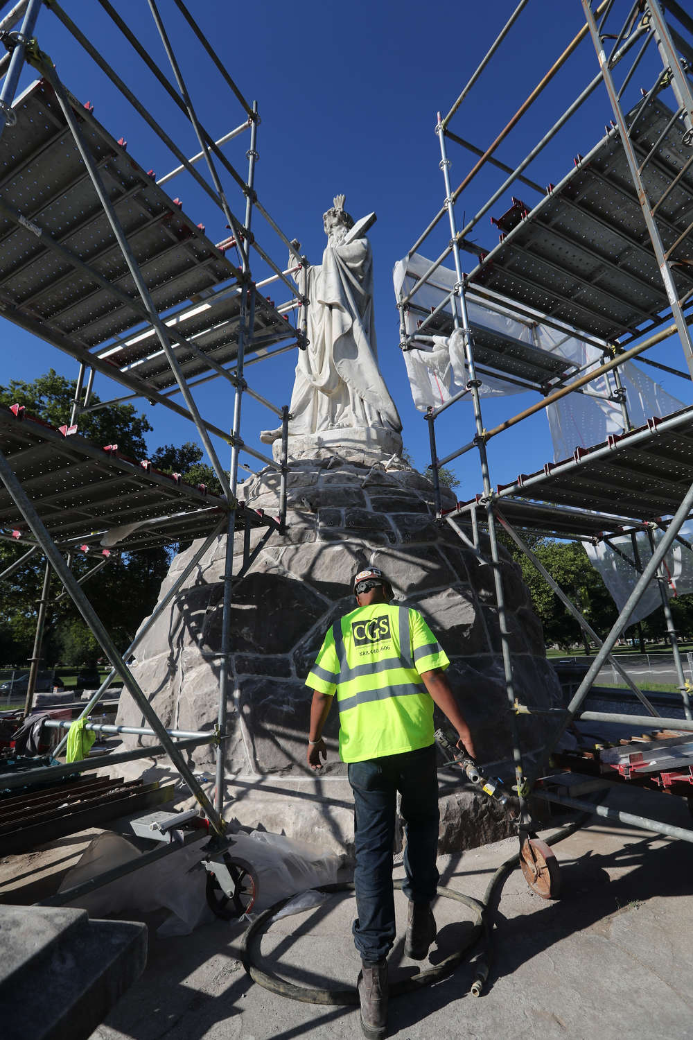 Workers injected high-mobility grout under low pressure at ground level and on scaffolding to access the towering statues.
