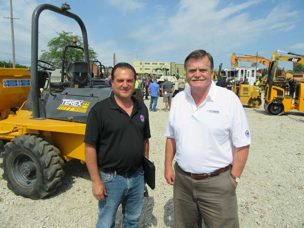 Don Risko (L) and Al Springer, both of Highway Equipment Company, stop by the auction.