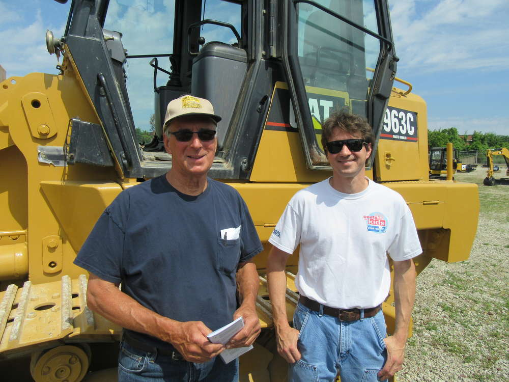 John (L) and Dave Hadam, both of Granger Tractor & Parts Inc., look for bargains at the auction.