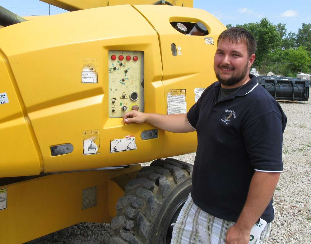 Josh Lee of Route 39 Equipment considers a bid on this Haulotte HB 44J boom lift.