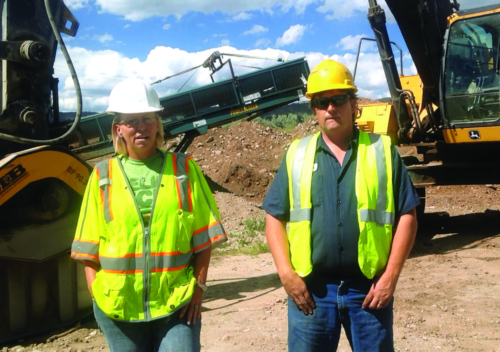 Tabitha Hapl (L) and Howard Houghton III, of Avalanche Excavating Inc. explain the benefits of purchasing the MB Crusher BF90.3 crushing attachment.