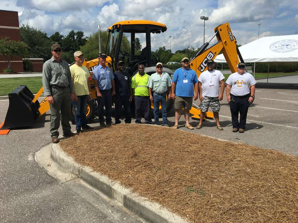 The state finalists in front of the JCB 3CX backhoe (L-R) are Josh Hyder, Greenville County; Bobby Hucherson, Spartanburg County; Thomas Nophsker, town of Surfside; Willie Myers, town of Surfside; Kevin Brown, Charleston County; Wade Wilder, Georgetown County; Michael Bollinger, city of West Columbia; Jamie Mack, Lexington County; and Matthew Bishop, Charleston County and 2016 state champion.