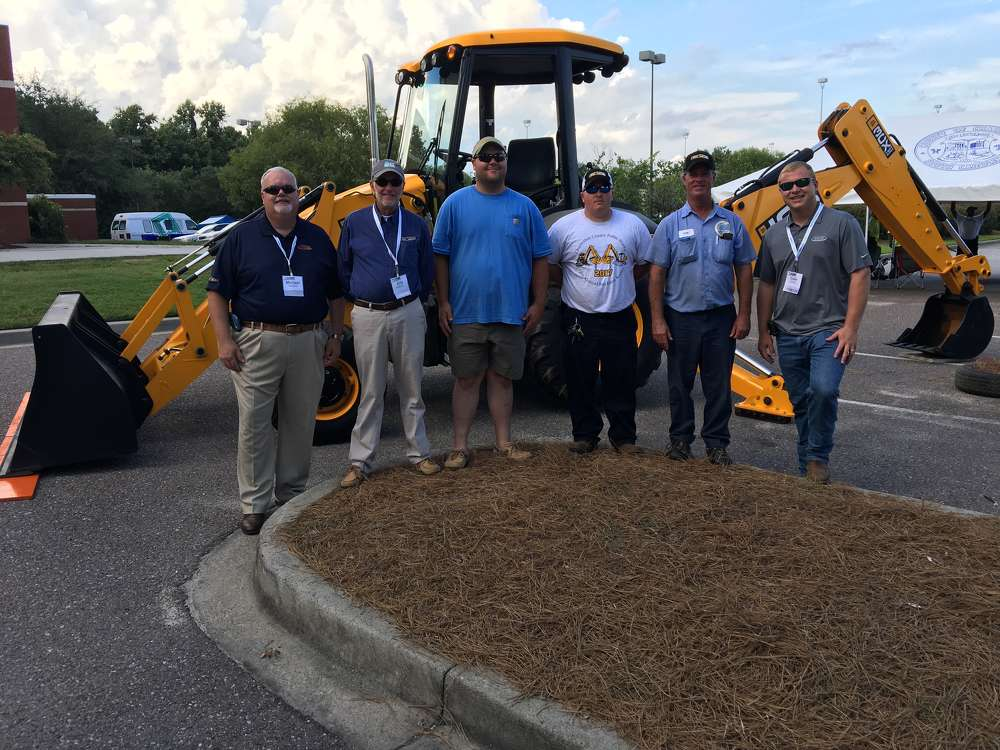(L-R): Michael Gilmartin and Billy Wall, both of Company Wrench, the JCB Dealer of North and South Carolina, stand with Michael Bollinger, first place winner; Matthew Bishop, second place winner; Tom Nophsker, third place winner and Colin Thain, also of Company Wrench.