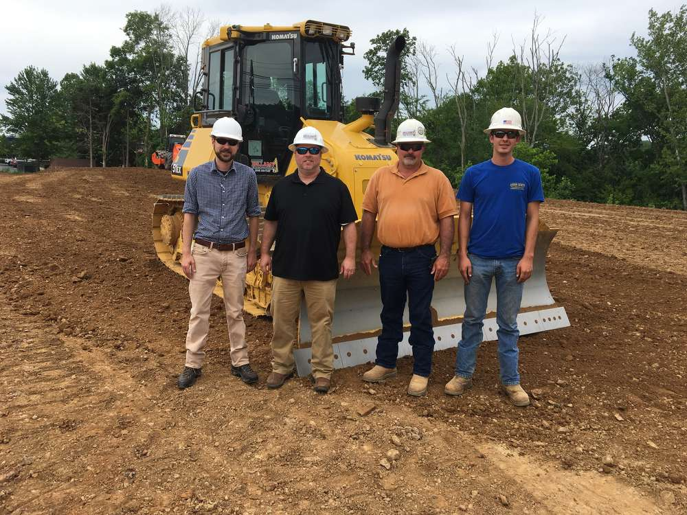 (L-R) are Aaron Kiser, salesperson of Power Equipment Company, and James Bellamy, chief manager, Chris Brown, superintendent, and Dustin Brown, operator, all of Bellamy Excavating.