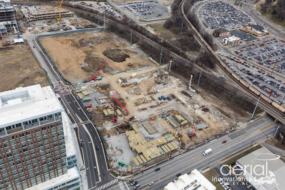 Construction teams in Nashville, Tenn., are working on the latest phase of a roughly $750 million, 32-acre mixed-use project that will feature offices, retail shops, restaurants, upscale multi-family residential units, hotels and a 2.5 acre urban activity park when complete. (Aerial Innovations photo)