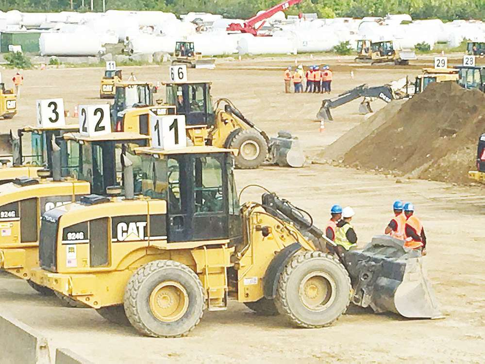 Students at the academy spend six weeks learning how to operate excavators, front-end loaders, skid steers, motor graders, backhoes, rollers, bulldozers and articulated dump trucks. (Credit: New Hampshire Union Leader)