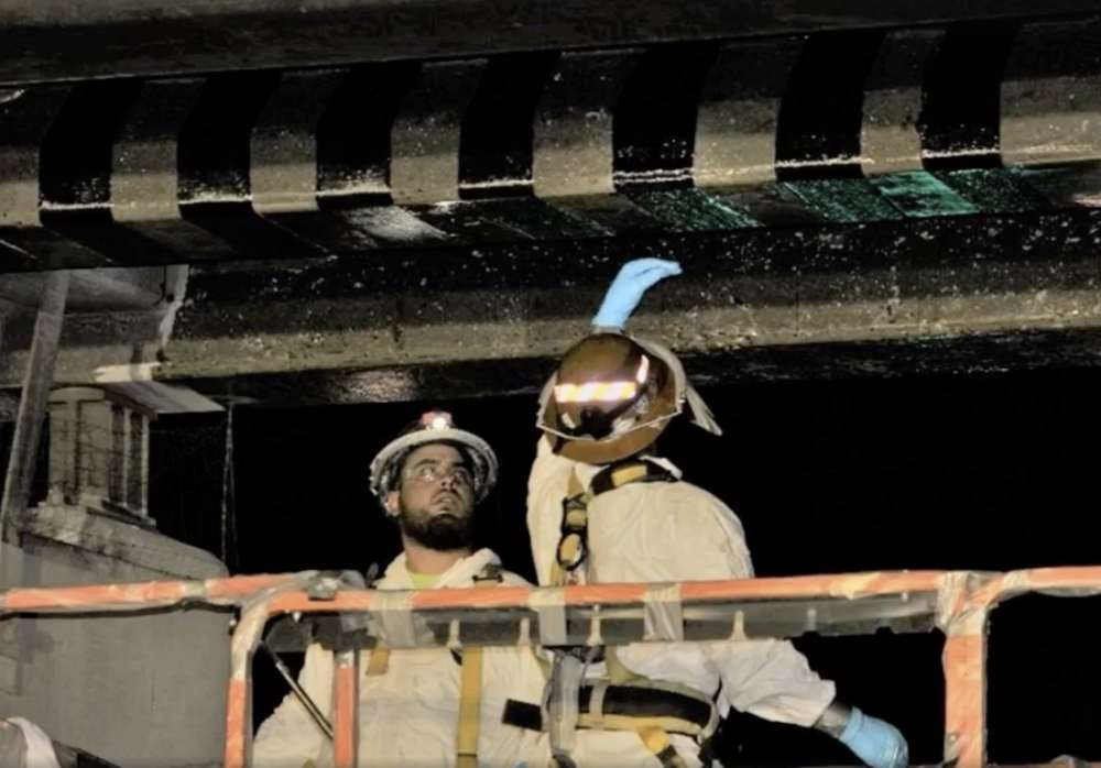 Crews used the strengthening material called Fiber Reinforced Polymer (FRP) to wrap the damaged girders. (ADOT photo)