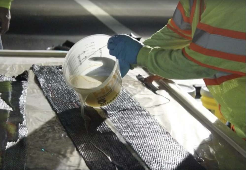ADOT used carbon fiber strips that are coated and strengthened with a reinforcing polymer to fix girders on state highway bridges. (ADOT photo)