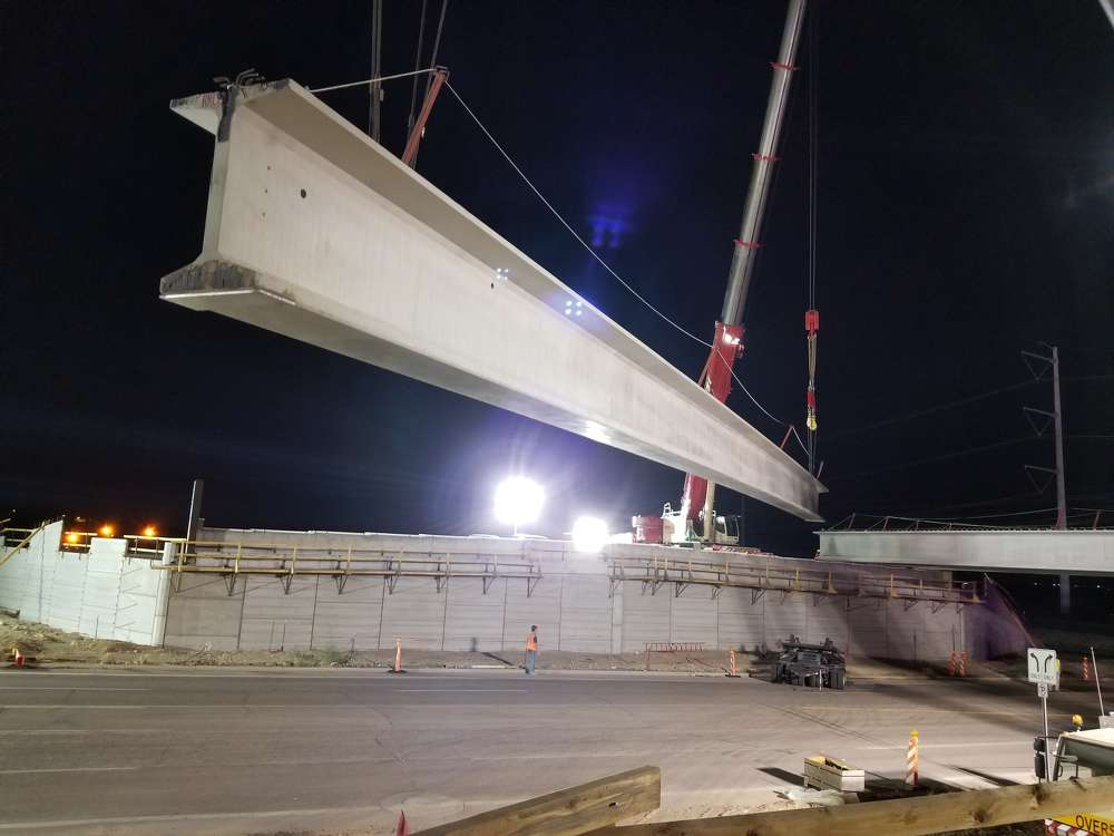 Two 450-ton cranes lifted and placed each of the 17 steel-reinforced concrete girders, which are 145 ft. long and weigh up to 131,000 lbs. (ADOT photo)