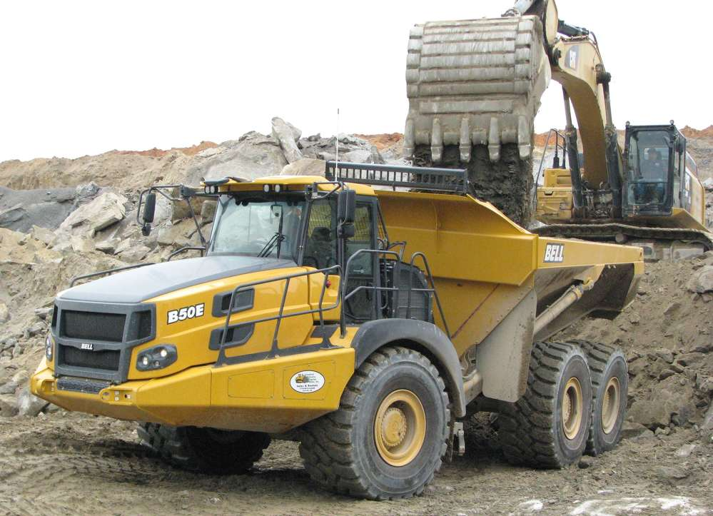 Lambert Construction's new Bell B50E 6x6 articulated truck takes on another stout load of overburden material.